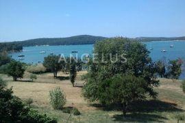 Istra, Medulin, građevinska parcela uz more, 1000m2, Medulin, أرض